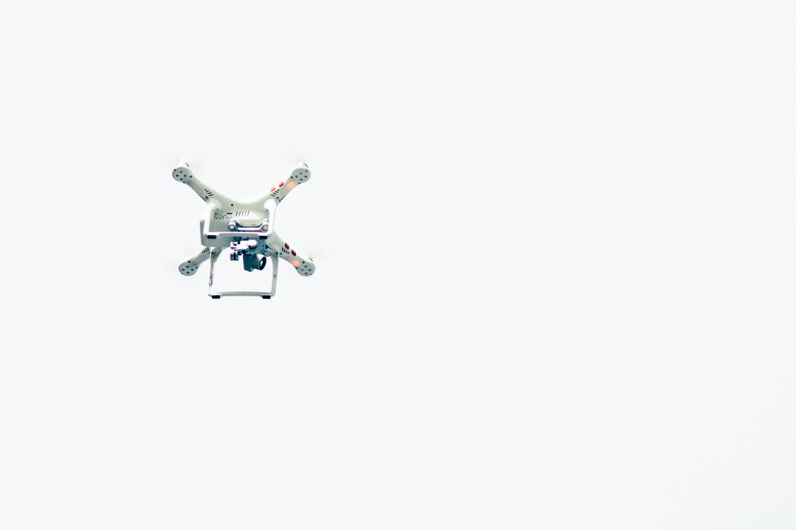 Drone flying in white sky